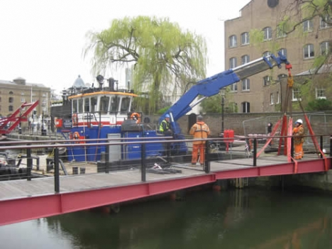 Repairing a damaged footbridge in St Katherine's Dock March 2014