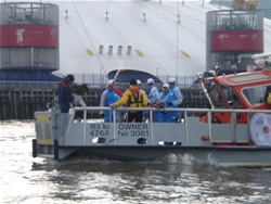 Filming the carrying of the Olympic Torch on the Thames April 2008